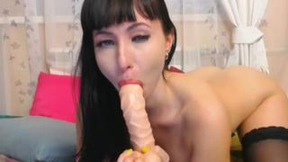 Hot Russian chick deepthroats a dildo