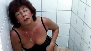 Redhead mature masturbates in lingerie Thumbnail